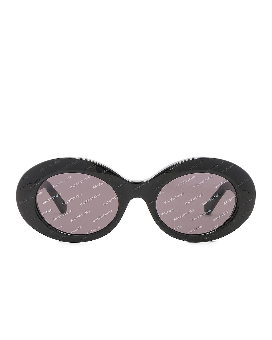 Image 1 of Balenciaga Oval Logomania Sunglasses in Black & Smoke