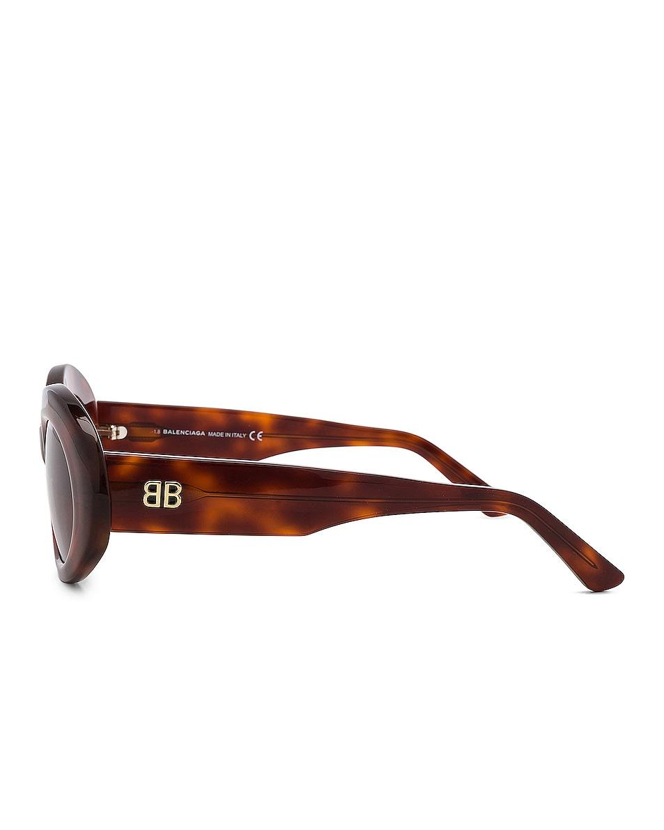 Image 3 of Balenciaga Oval Sunglasses in Blonde Havana & Burgundy