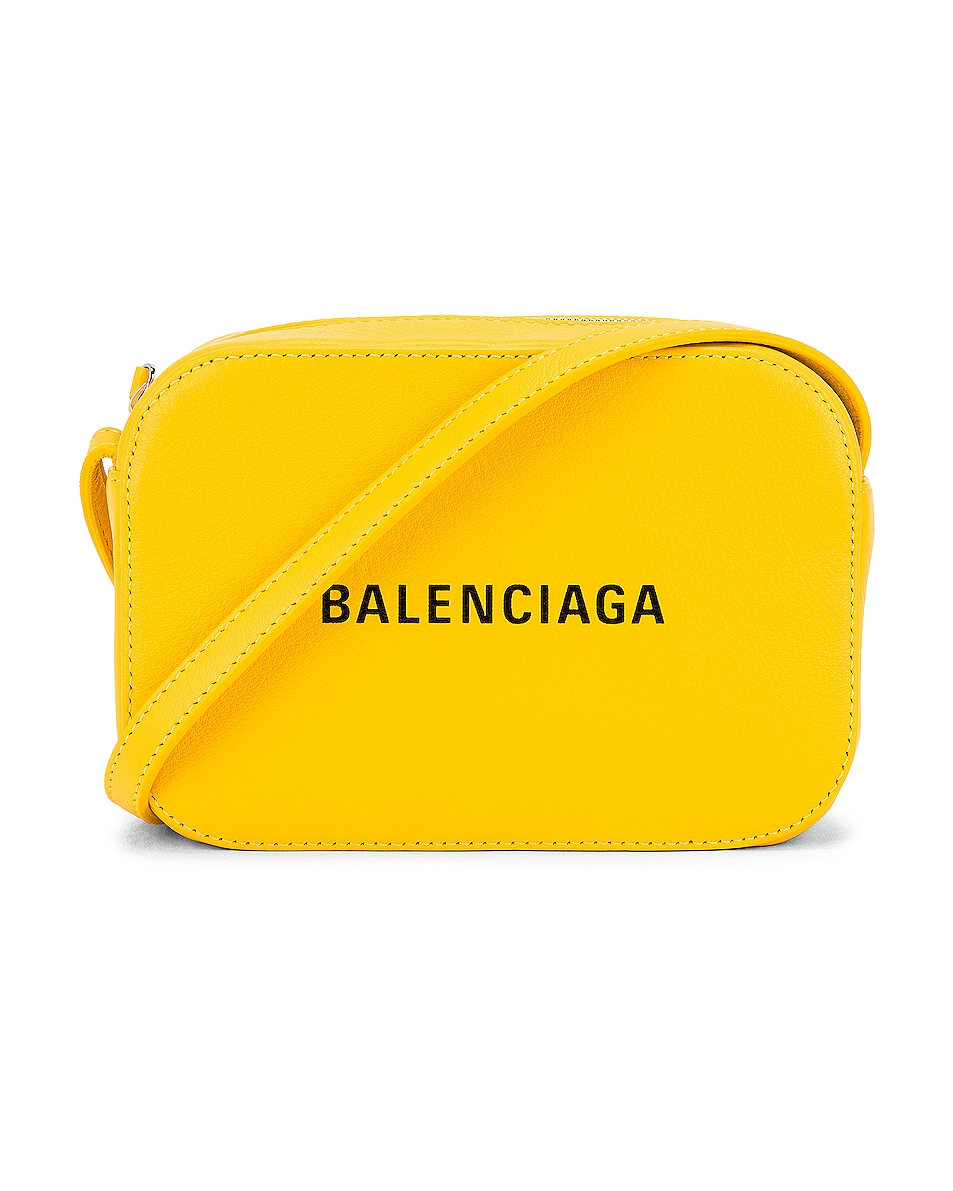 Image 1 of Balenciaga XS Logo Everyday Camera Bag in Yellow & Black