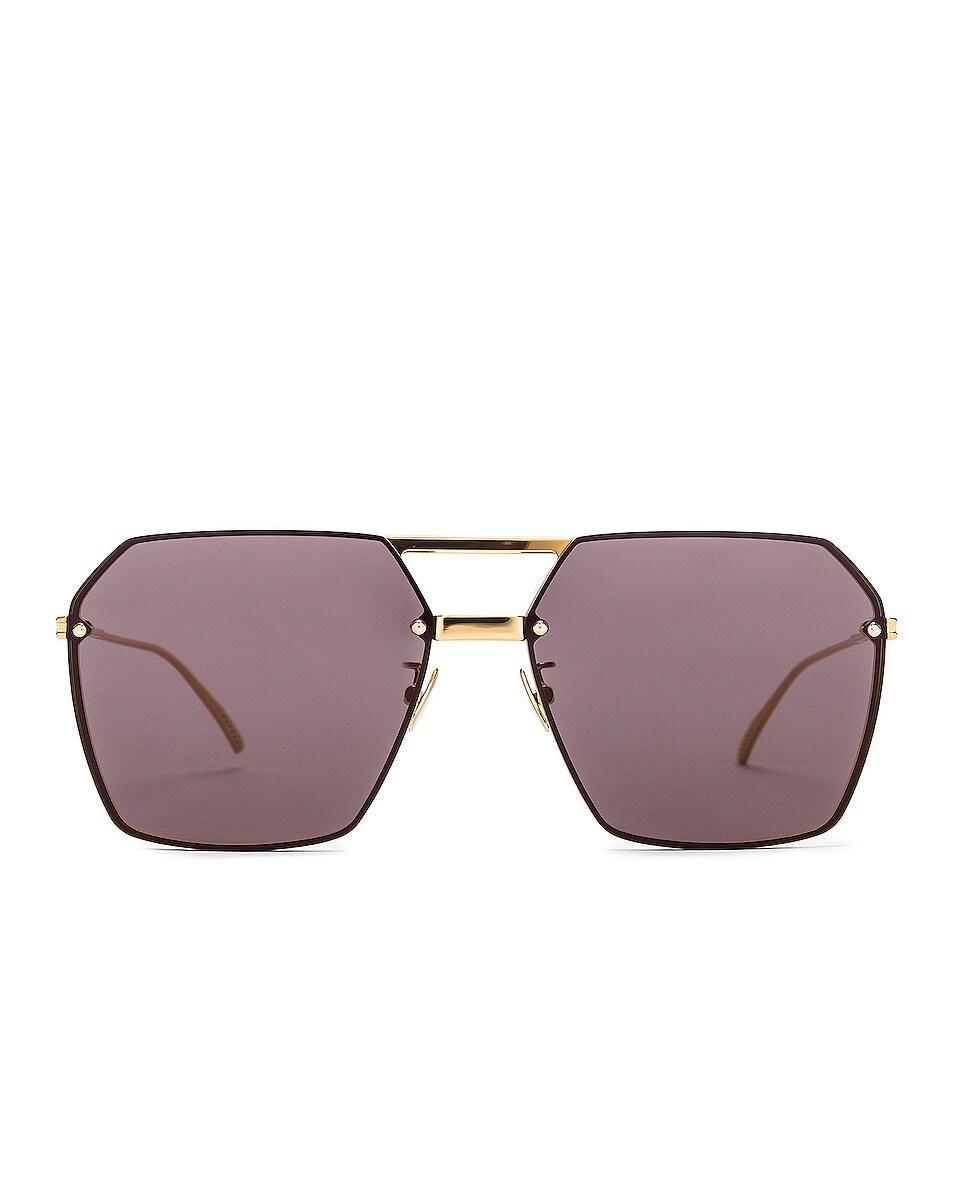 Image 1 of Bottega Veneta Oversized Geometric Metal Sunglasses in Shiny Gold & Grey
