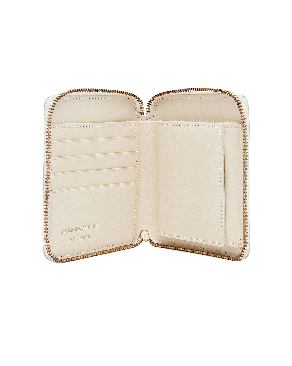 Image 4 of Comme Des Garcons Star Embossed Zip Fold Wallet in Off White