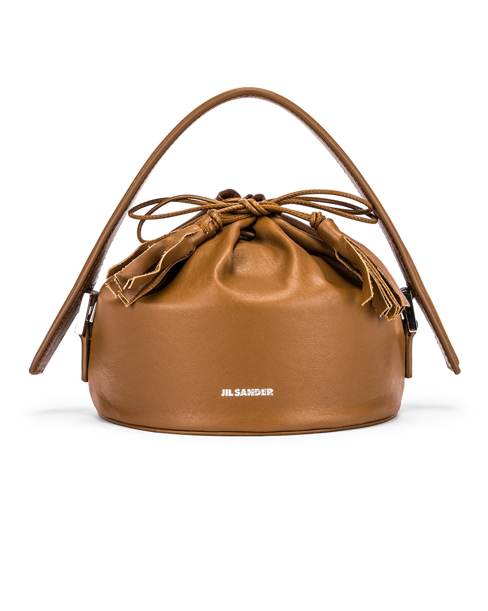 Image 1 of Jil Sander Small Drawstring Drum Bag in Tan