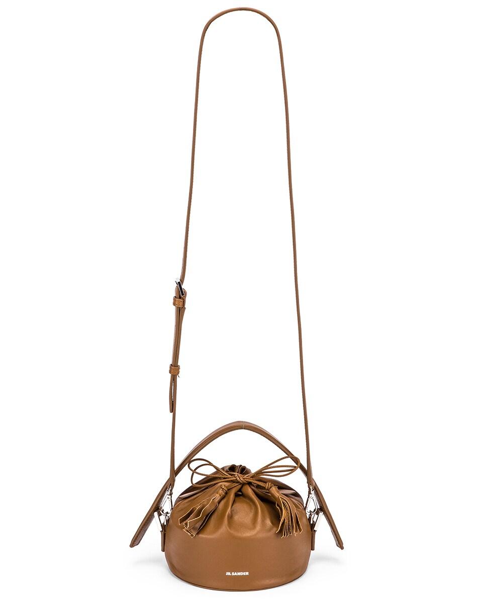 Image 6 of Jil Sander Small Drawstring Drum Bag in Tan