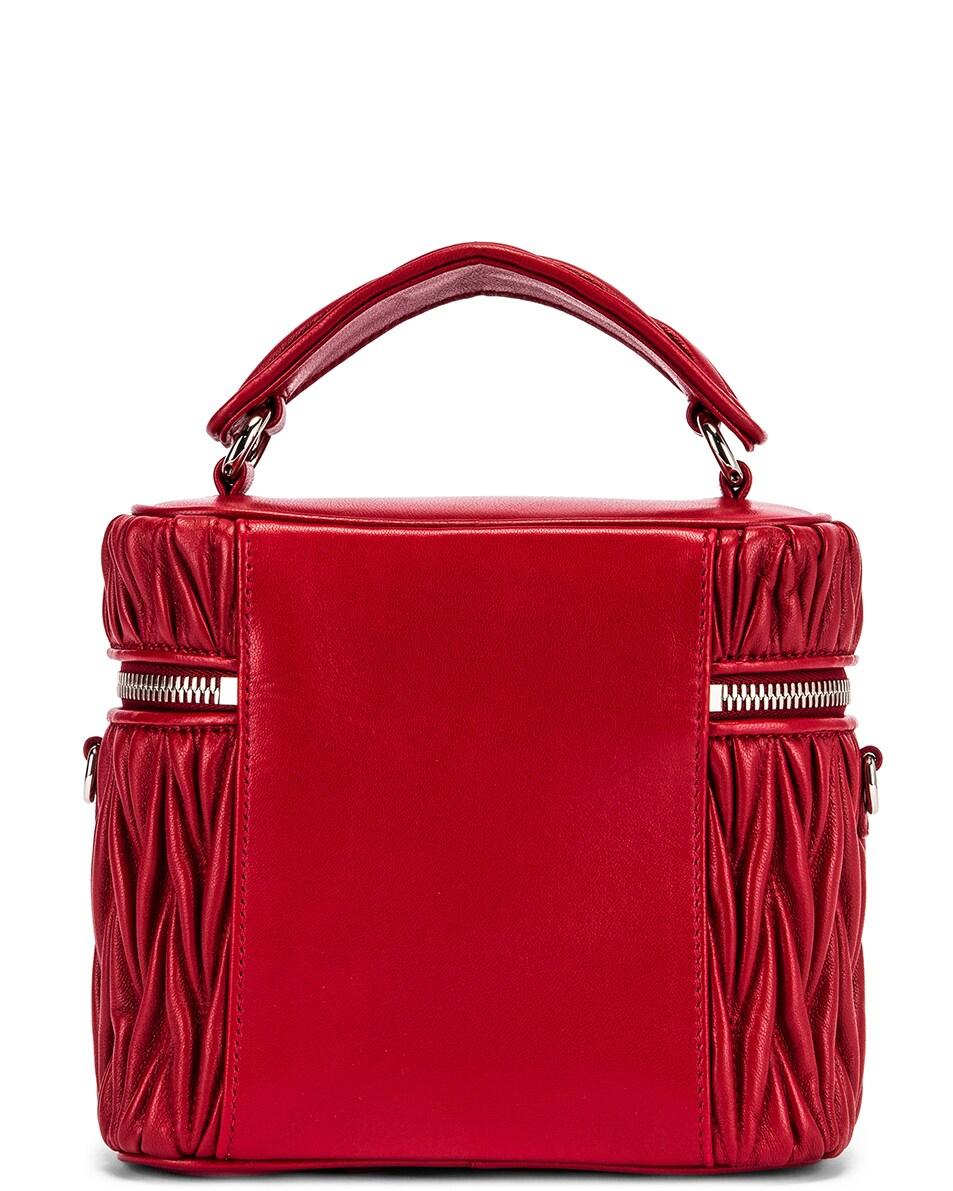 Image 2 of Miu Miu Quilted Mini Bag in Fuoco