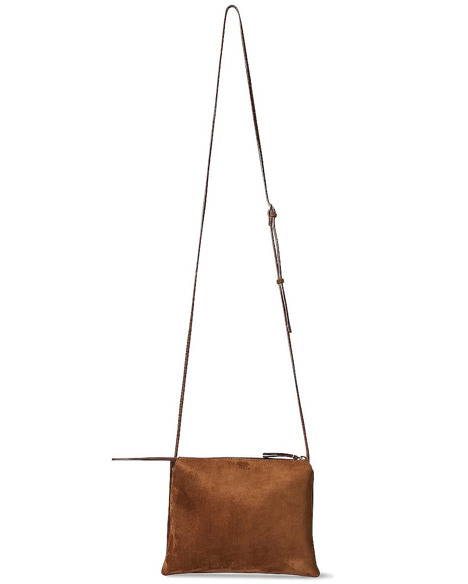 Image 1 of The Row Nu Mini Twin Suede Crossbody Bag in Caramel