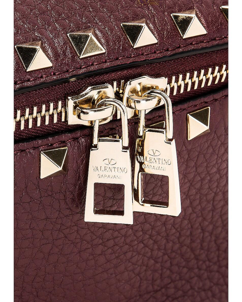 Image 7 of Valentino Rockstud Belt Bag in Rubin