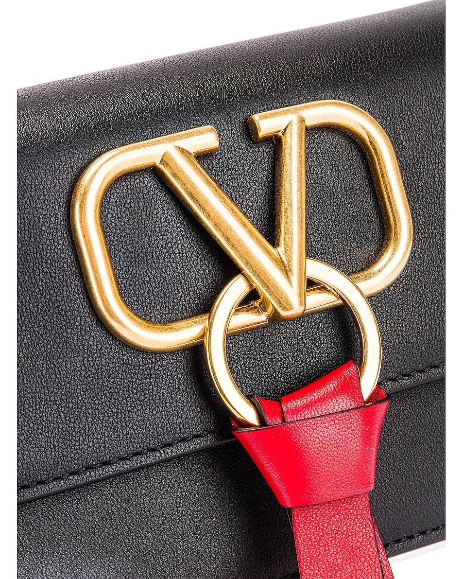 Image 8 of Valentino V Logo Ribbon Crossbody Bag in Black & Red