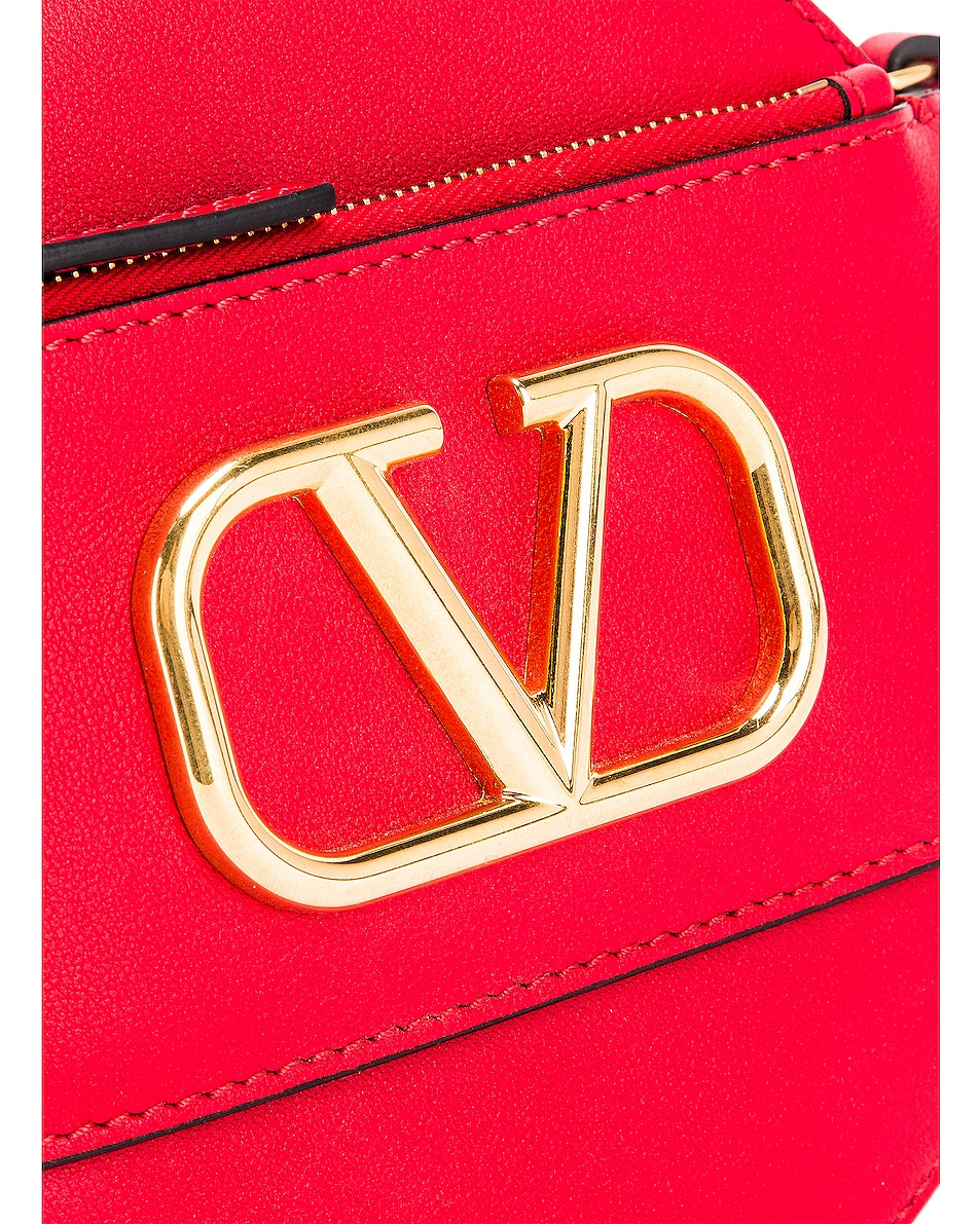 Image 8 of Valentino V Logo Circle Crossbody Bag in Red