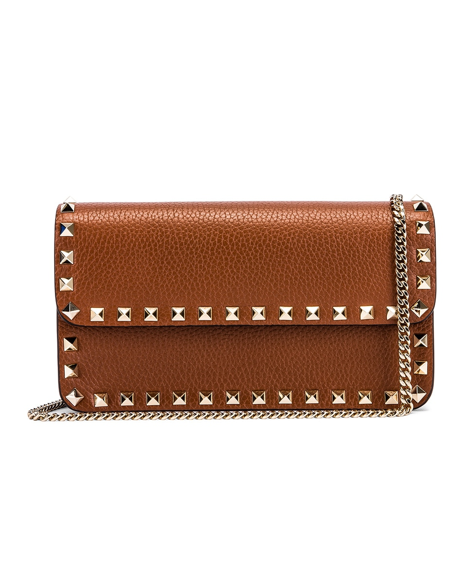 Image 1 of Valentino Rockstud Flap Crossbody Bag in Bright Cognac