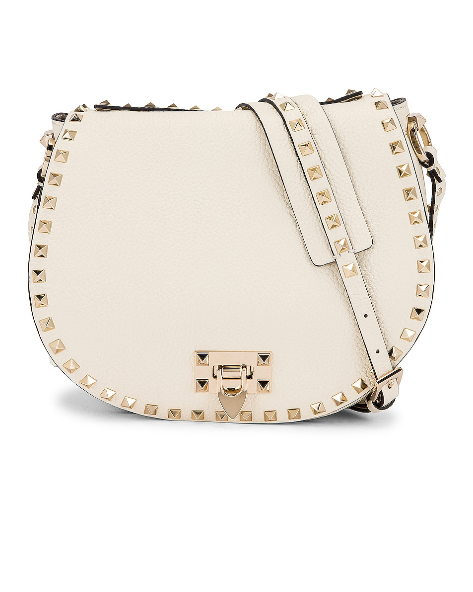 Image 1 of Valentino Small Rockstud Saddle Bag in Light Ivory