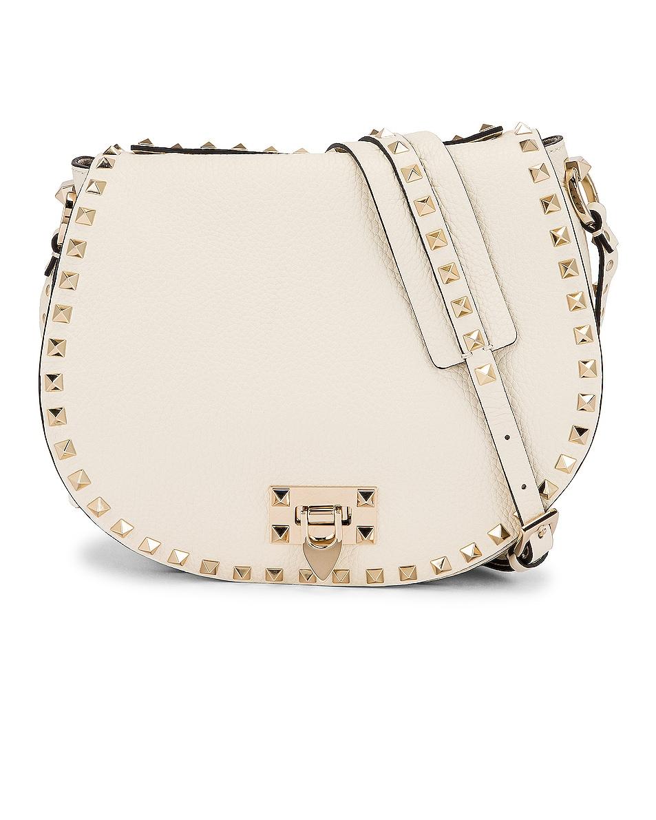 Image 1 of Valentino Small Rockstud Saddle Bag in Light Ivory