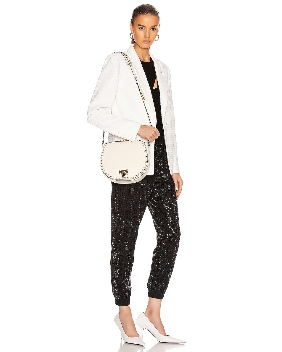 Image 2 of Valentino Small Rockstud Saddle Bag in Light Ivory