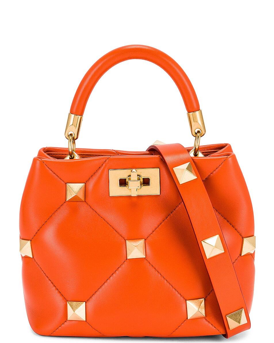 Image 1 of Valentino Garavani Small Roman Stud Top Handle Bag in Orange Zest