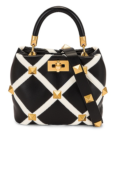 Valentino Garavani Small Roman Stud Top Handle Bag in Nero & Ivory   FWRD