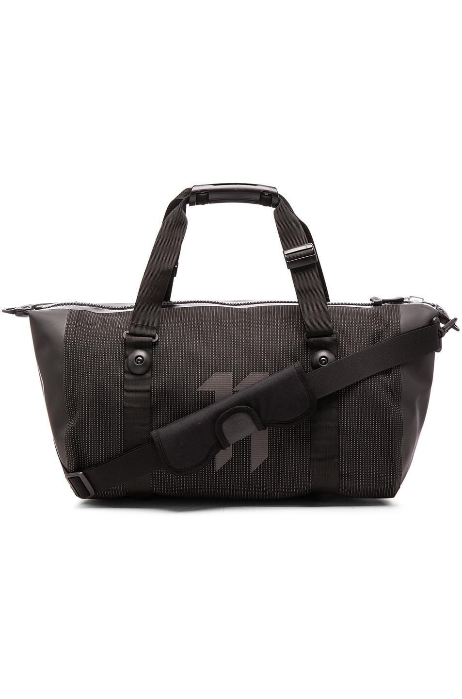 891a4007470 Image 1 of 11 by Boris Bidjan Saberi Travel Zip Bag in Black High Visibility