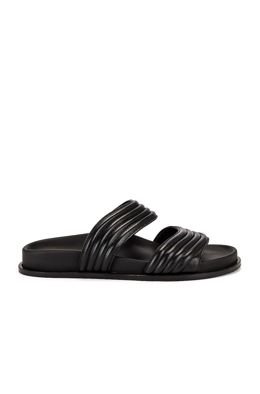 Image 1 of ALAÏA Leather Slides in Noir