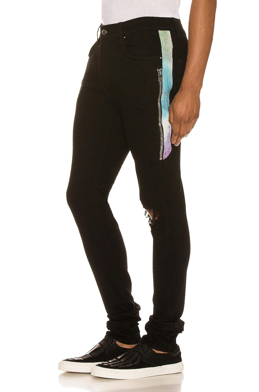 Image 1 of Amiri Watercolor Half Track Jean in Black