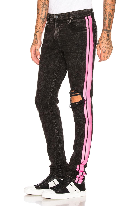 Image 1 of Amiri Broken Track Jean in Acid Wash Black & Neon Pink
