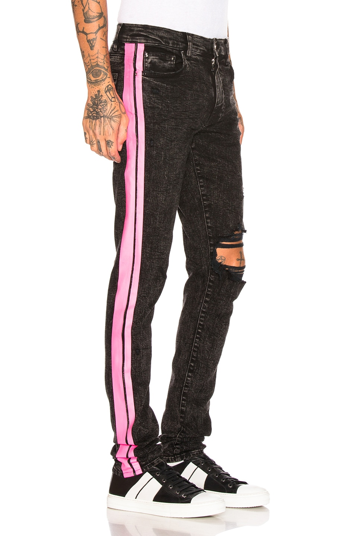 Image 3 of Amiri Broken Track Jean in Acid Wash Black & Neon Pink