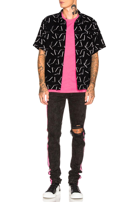 Image 5 of Amiri Broken Track Jean in Acid Wash Black & Neon Pink