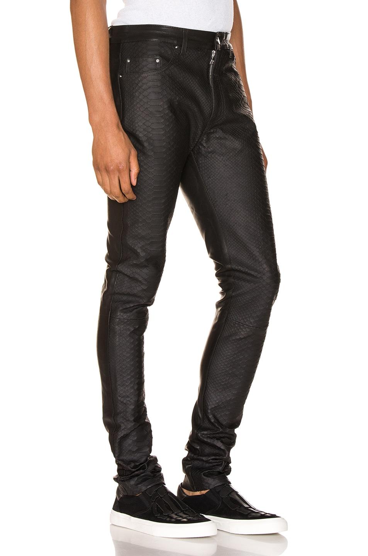 Image 2 of Amiri Half Printed Python Leather Pants in Black