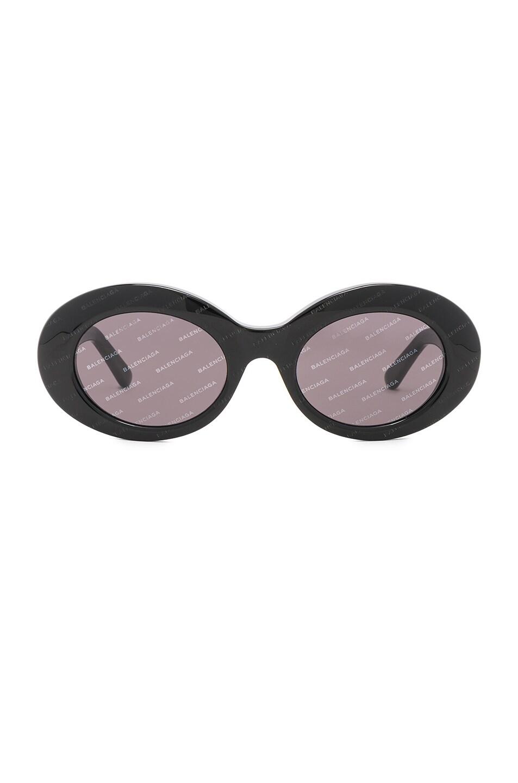 Image 1 of Balenciaga Oval Logomania Sunglasses in Black & Smoke