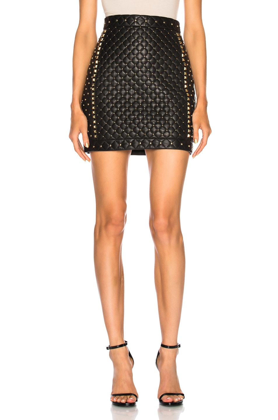 8b3f0795eff Image 1 of BALMAIN Studded Quilted Leather Mini Skirt in Black