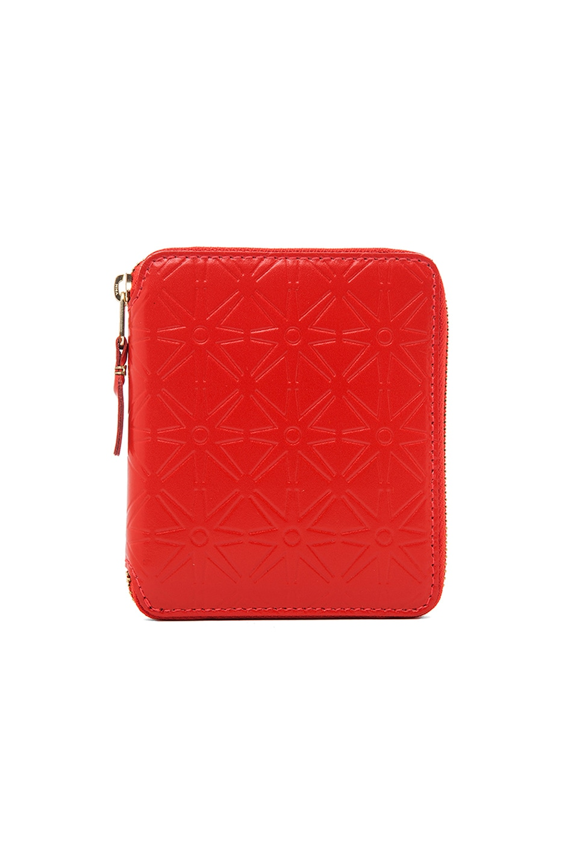 Image 1 of Comme Des Garcons Star Embossed Zip Fold Wallet in Orange