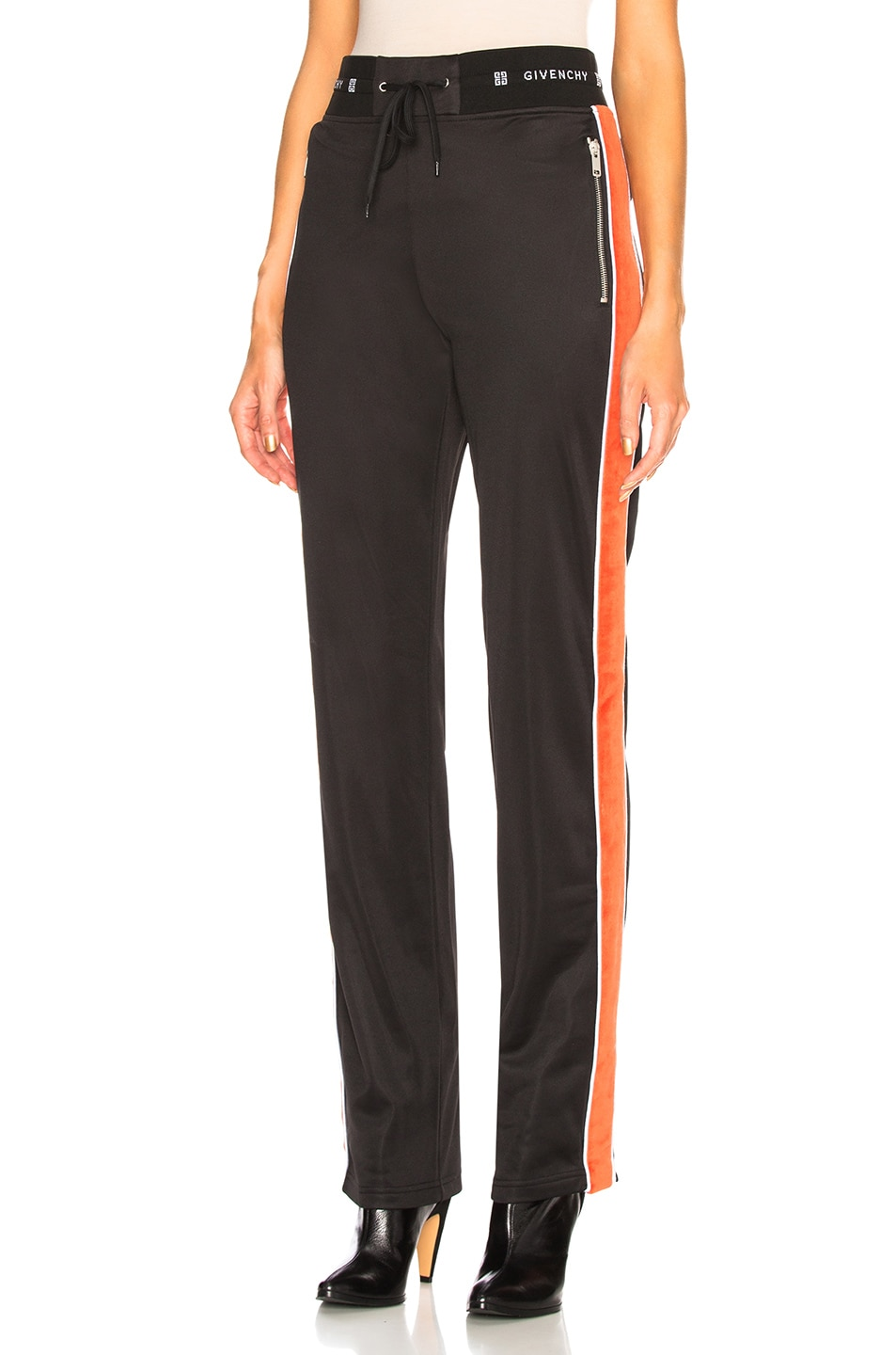 Image 1 of Givenchy Technical Neoprene Jersey Joggers in Black & Orange