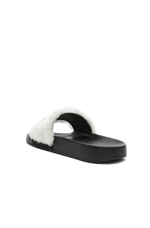 Image 4 of Givenchy Lamb Shearling Logo Slides in White & Black