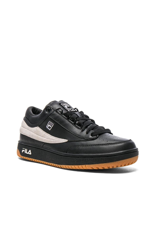 Image 1 of Gosha Rubchinskiy x Fila T1 Mid Leather Sneakers in Black & White