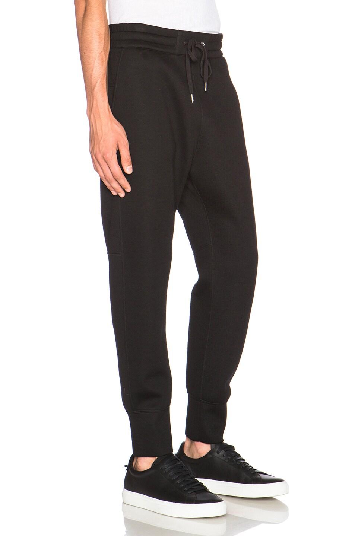 47ccdb34197f22 Image 3 of Helmut Lang Sponge Fleece Curved Leg Track Pants in Black