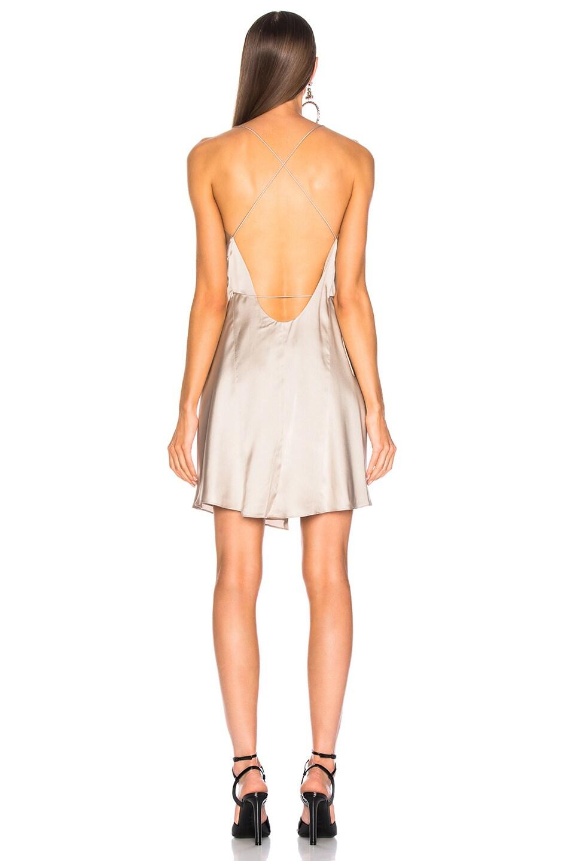 Image 4 of Michelle Mason for FWRD Strappy Wrap Mini Dress in Champagne Satin