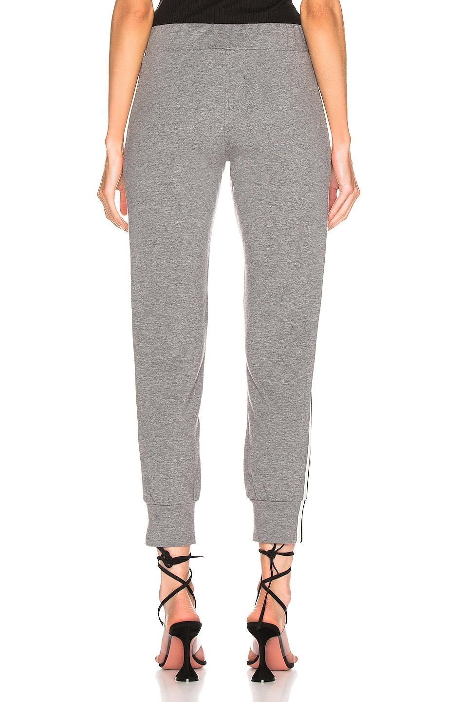 Image 4 of Norma Kamali Side Stripe Jog Pant in Medium Heather Grey & Engineered Stripe
