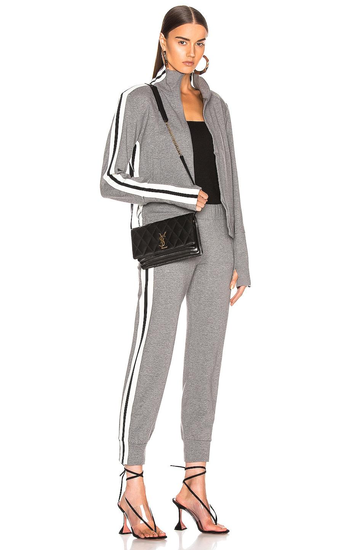 Image 5 of Norma Kamali Side Stripe Jog Pant in Medium Heather Grey & Engineered Stripe
