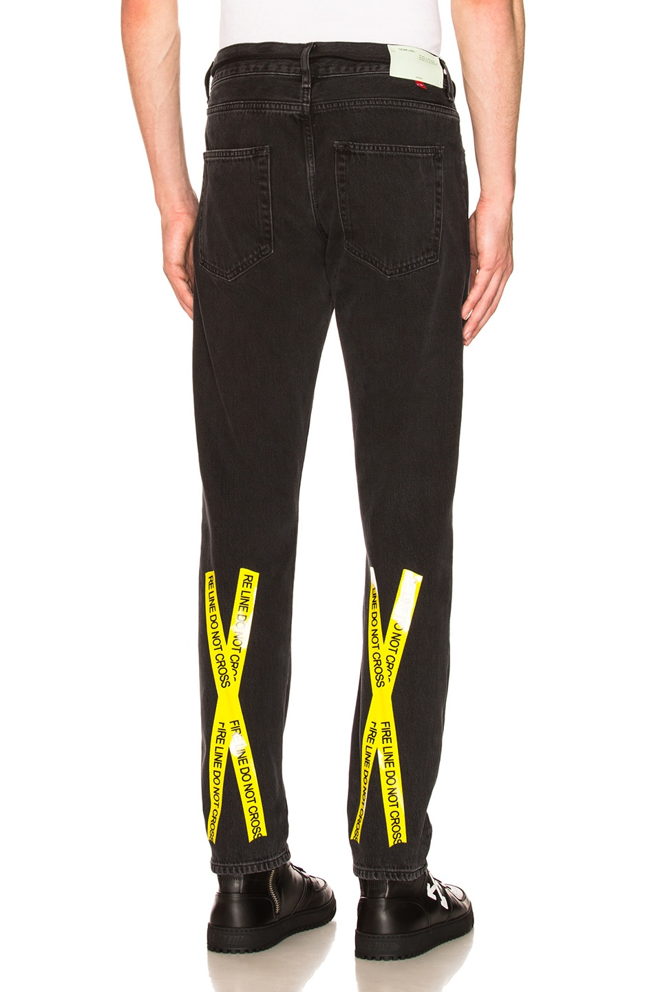 c813ca115a21 Image 1 of OFF-WHITE Firetape Slim Jeans in Black   Yellow