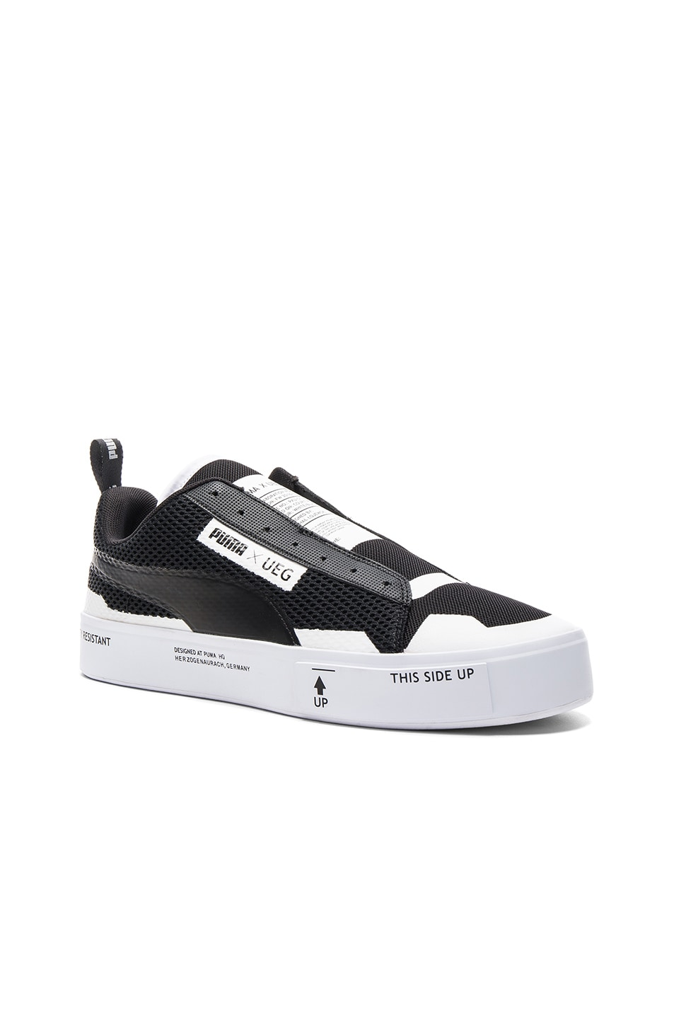 3d338ad24a97 Image 1 of Puma Select x UEG Court Play Slip Ons in Black   White