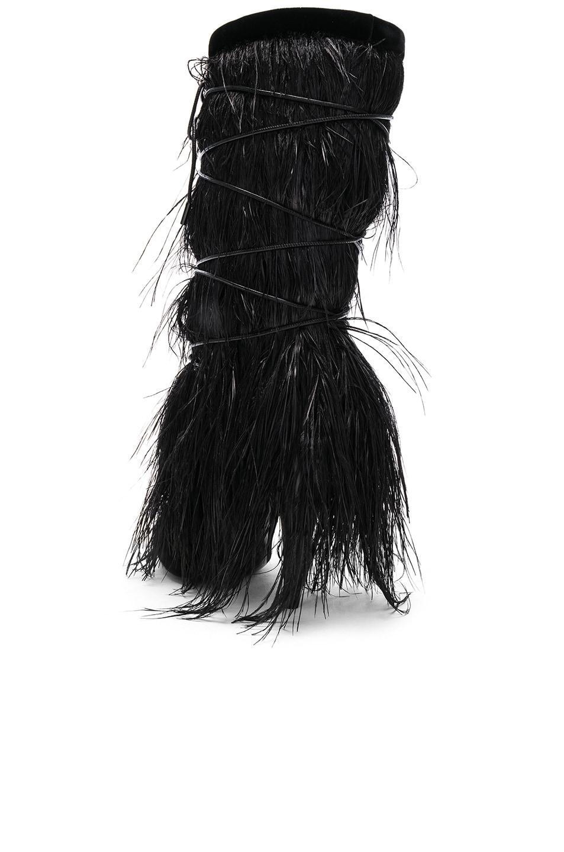 Image 3 of Saint Laurent Era Feather Embellished Velvet Yeti Boots in Black