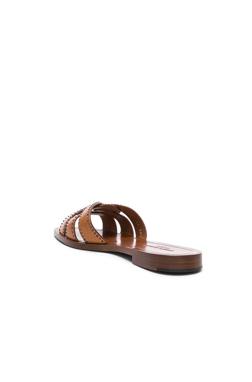 Image 3 of Saint Laurent Studded Leather Nu Pieds Slides in Amber