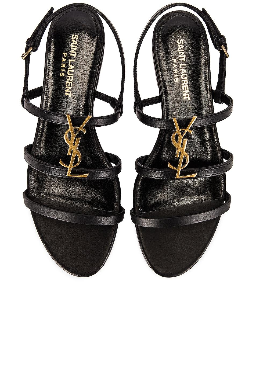 Image 1 of Saint Laurent Cassandra Patent Leather Flat Sandals in Noir