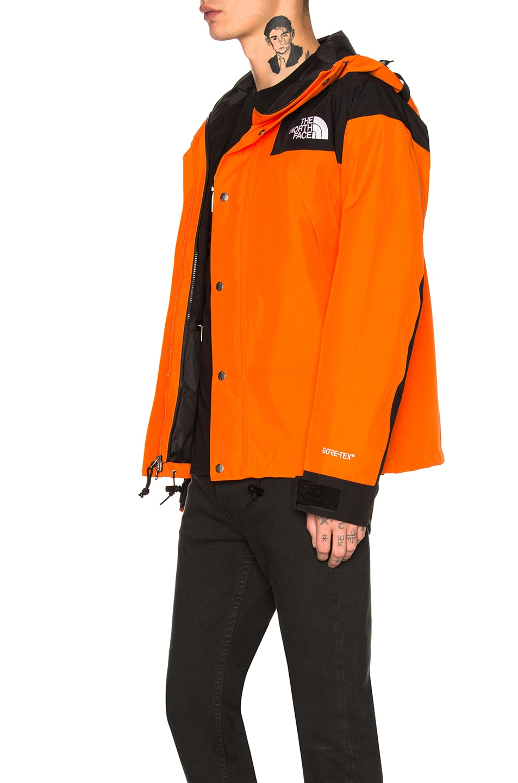 376669913 The North Face 1990 Mountain Jacket GTX in Persian Orange | FWRD