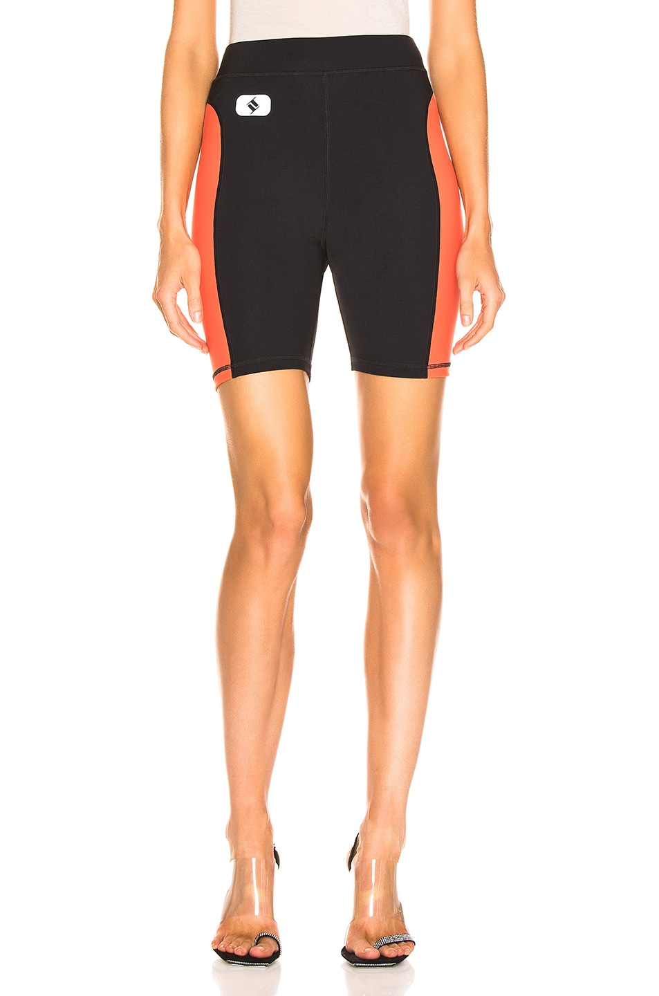 Image 1 of T by Alexander Wang Swim Biker Short in Black & Papaya