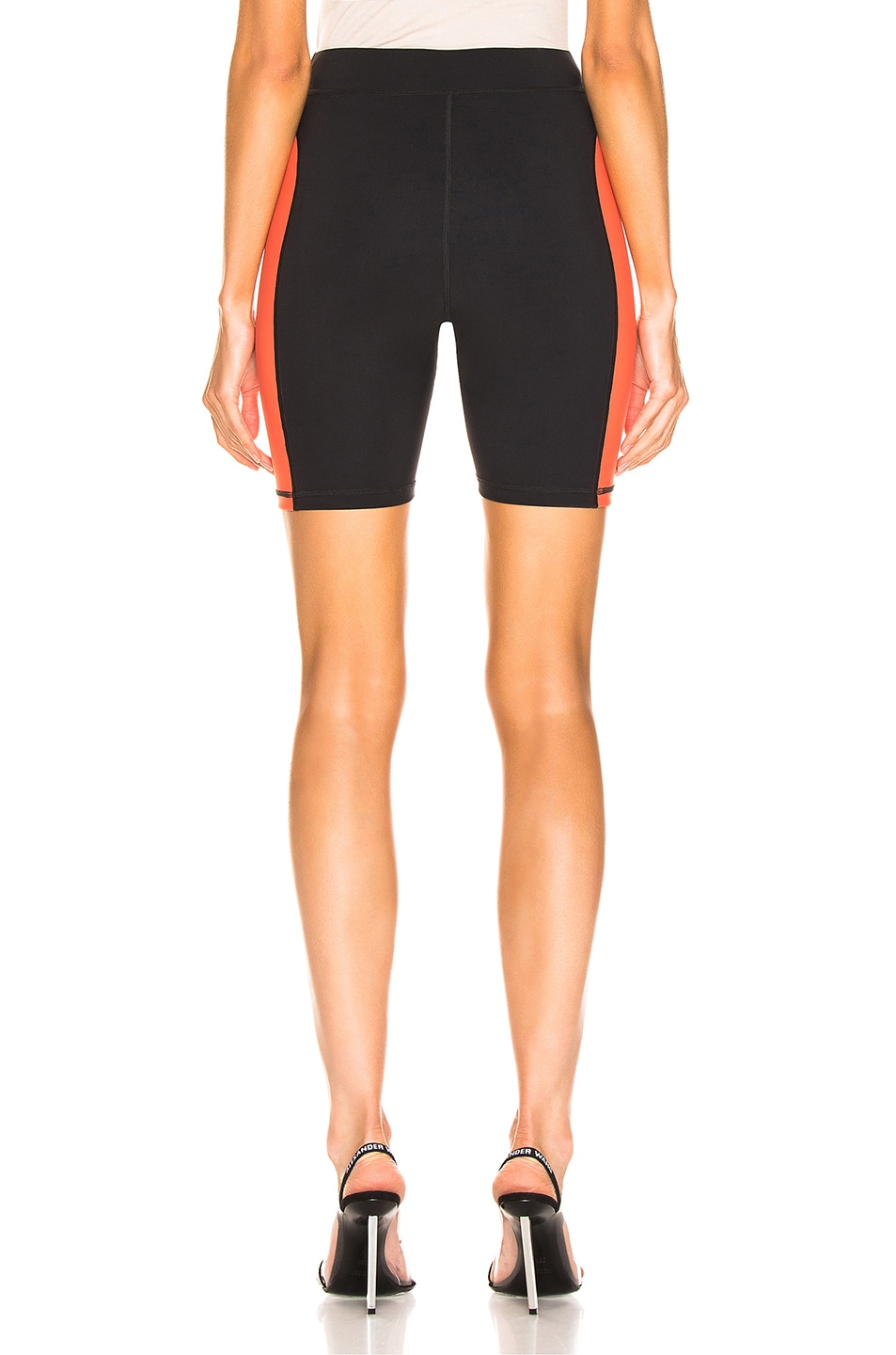 Image 4 of T by Alexander Wang Swim Biker Short in Black & Papaya