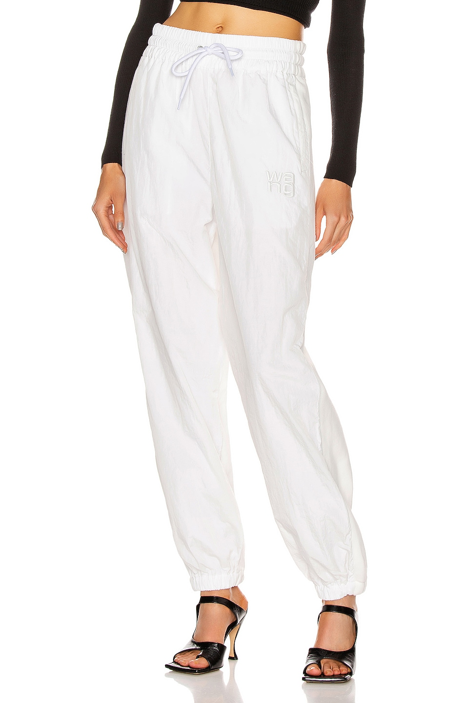 Image 1 of T by Alexander Wang Raised Logo Embroidery Terry Hybrid Pant in White