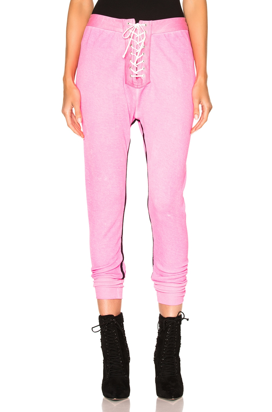 Image 1 of Unravel for FWRD Lace Up Leggings in Sunfaded Neon Pink