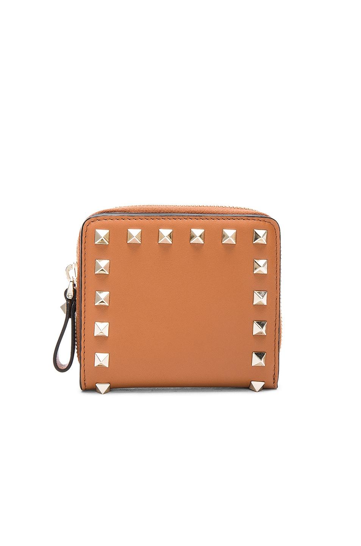 48493eed15b Image 1 of Valentino Rockstud Zip Around Wallet in Light Cuir
