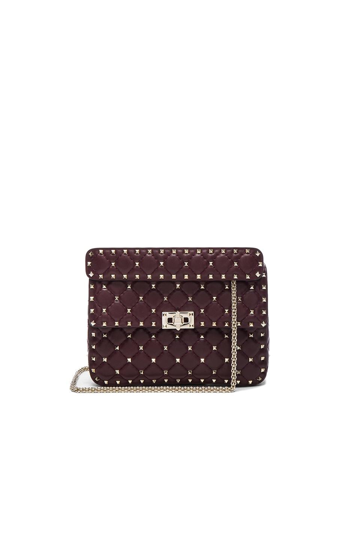 8762e5e55e9 Image 1 of Valentino Quilted Rockstud Spike Medium Chain Bag in Rubin