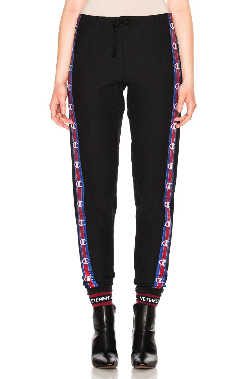 87145c30ffd4b5 Image 1 of VETEMENTS x Champion Knee Shaped Tape Sweatpants in Black
