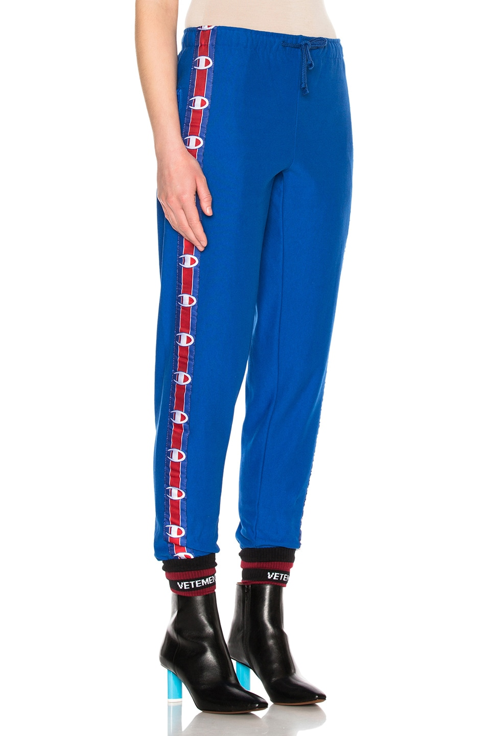 Image 4 of VETEMENTS x Champion Knee Shaped Tape Sweatpants in Blue