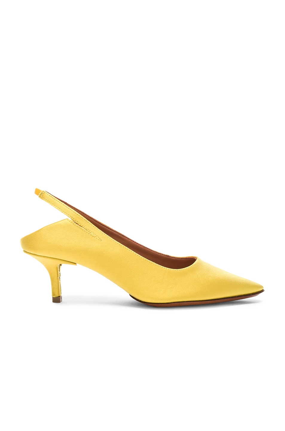 2a270a4e080 Image 1 of VETEMENTS Satin Slingback Kitten Heels in Yellow